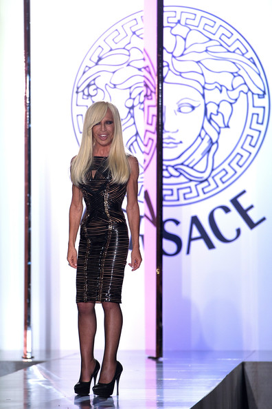 Donatella Versace acknowledges the applause of the audience after the Versace Haute-Couture show as part of Paris Fashion Week Fall / Winter 2013 at the Ritz hotel on July 1, 2012 in Paris, France.