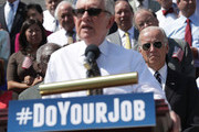 """U.S. Senate Minority Leader Sen. Harry Reid (D-NV) speaks as Vice President Joseph Biden and other Senate and House Democrats listen during a press event on the House East Front Steps of the Capitol September 8, 2016 in Washington, DC. Congressional Democrats urge the Republicans to """"do your job!"""""""