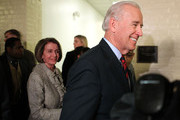 U.S. Vice President Joseph Biden (R), followed by Speaker of the House Rep. Nancy Pelosi (D-CA) (L), leaves after a meeting with House Democrats December 8, 2010 on Capitol Hill in Washington, DC. Biden was on the Hill to discuss the extending of Bush-era tax cuts.