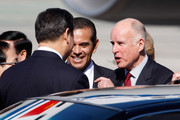 Chinese Vice President Xi Jinping is greeted by Los Angeles mayor Antonio Villaraigosa (C) and California governor Jerry Brown (R) upon as he arrives to Los Angeles International Airport (LAX) on February 16, 2012 in Los Angeles, California. Xi Jinping will tour the China shipping terminal at the Port of Los Angeles with California governor Jerry Brown and Los Angeles mayor Antonio Villaraigosa today and members of his delegation will attend a seminar on U.S.-China trade relations and shared economic interests.