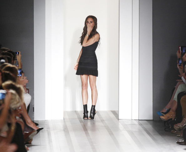 Designer Victoria Beckham poses on the runway at the Victoria Beckham Spring 2013 presentation during Mercedes-Benz Fashion Week at New York Public Library on September 9, 2012 in New York City.