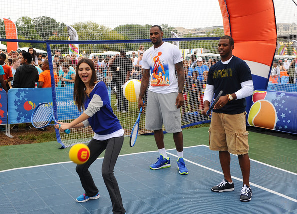 Victoria Justice NBA players LeBron James and Chris Paul play tennis with Victoria Justice during Nickelodeon celebrates largest ever Worldwide Day of Play at the Ellipse on September 24, 2011 in Washington, DC.