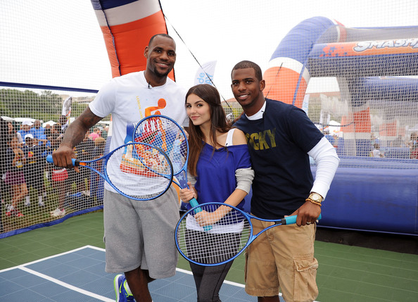 Victoria Justice NBA players LeBron James and Chris Paul play tennis with Victoria Justice (center) during Nickelodeon celebrates largest ever Worldwide Day of Play at the Ellipse on September 24, 2011 in Washington, DC.