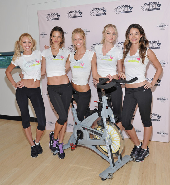 (L-R) Victoria's Secret models Candice Swanepoel, Alessandra Ambrosio, Erin Heatherton, Lindsay Ellingson, and Lily Aldridge attend the Victoria's Secret Supermodel cycle to benefit cancer at SoulCycle Tribeca on July 12, 2011 in New York City.