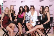 Erin Heatherton, Adriana Lima, Alessandra Ambrosio and Lily Aldridge pose with a fan at the Victoria's Secret Fashion's Night Out event at Victoria's Secret, SoHo on September 8, 2011 in New York City.