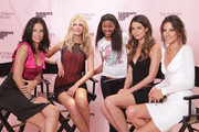 Adriana Lima, Erin Heatherton, Lily Aldridge and Alessandra Ambrosio pose for a photo with a fan at the Victoria's Secret Fashion's Night Out event at Victoria's Secret, SoHo on September 8, 2011 in New York City.