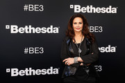 Actress Lynda Carter poses for a photograph as she arrives to the Bethesda E3 2015 press conference at the Dolby Theatre on June 14, 2015 in Los Angeles, California. The Bethesda press conference is held in conjunction with the annual Electronic Entertainment Expo (E3) which focuses on gaming systems and interactive entertainment, featuring introductions to new products and technologies.