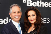 Chairman and CEO of ZeniMax Media, Robert A. Altman and actress/wife Lynda Carter pose for a photograph as they arrive to the Bethesda E3 2015 press conference at the Dolby Theatre on June 14, 2015 in Los Angeles, California. The Bethesda press conference is held in conjunction with the annual Electronic Entertainment Expo (E3) which focuses on gaming systems and interactive entertainment, featuring introductions to new products and technologies.