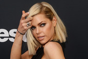 Actress Sophie Monk poses for a photograph as she arrives to the Bethesda E3 2015 press conference at the Dolby Theatre on June 14, 2015 in Los Angeles, California. The Bethesda press conference is held in conjunction with the annual Electronic Entertainment Expo (E3) which focuses on gaming systems and interactive entertainment, featuring introductions to new products and technologies.