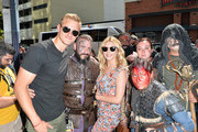 Alexander Ludwig (L) and Katheryn Winnick (C) take a photo with fans during Vikings Battle Axe Training at San Diego Comic-Con 2019 on July 20, 2019 in San Diego, California.