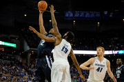 Kris Jenkins #2 of the Villanova Wildcats shoots the ball over Cole Huff #13 of the Creighton Bluejays during their game at CenturyLink Center on January 2, 2016 in Omaha, Nebraska.