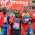 Emmanuel Mutai Photos - Emmanuel Mutai of Kenya , Tsegaye Kebede of Ethopia and Jaquad Gharib of Morocco pose for the camera's during the 2010 Virgin London Marathon on April 25, 2010 in London, England. - Virgin London Marathon 2010