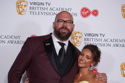 Tom Davis and Michelle Keegan pose in the press room at the Virgin TV British Academy Television Awards at The Royal Festival Hall on May 13, 2018 in London, England.