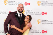 (L-R) Tom Davis and Michelle Keegan pose in the press room at the Virgin TV British Academy Television Awards at The Royal Festival Hall on May 13, 2018 in London, England.