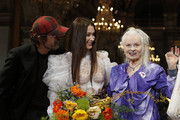 Image contains nudity.) Andreas Kronthaler, US model Bella Hadid model and British designer Vivienne Westwood pose at the end the Vivienne Westwood show as part of the Paris Fashion Week Womenswear Fall/Winter 2020/2021 on February 29, 2020 in Paris, France.