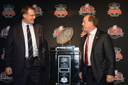 (L-R) Auburn Tigers Head Coach Gus Malzahn and Florida State Seminoles Head Coach Jimbo Fisher chat in front of the trophy during a Vizio BCS National Championship press conference at the Newport Beach Marriot Hotel and Spa on January 5, 2014 in Newport Beach, California.
