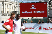 (L-R) Ex Arsenal legend Tony Adams and Ex Tottenham Hostspur legend Ledley King during the Vodafone 4G Goes Live Launch at Trafalgar Sqaure on August 29, 2013 in London, United Kingdom.  Vodafone kicks off 4G network in London with a choice of Sky Sports TV or Spotify Premium, before launching in 12 more cities before the end of the year.