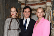 (L-R) Eva Herzigova, Emanuele Farneti and Amber Valletta attend the Vogue Yoox Challenge - The Future of Responsible Fashion Dinner event at S. Paolo Converso on February 22, 2020 in Milan, Italy.