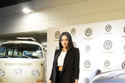 Shay Mitchell poses with electrified Volkswagen Type 2 Bus and the all-new 2020 Atlas Cross Sport during the Fourth Annual Volkswagen Drive-In at the Petersen Automotive Museum on November 21, 2019 in Los Angeles, California.