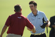 Lee Westwood of England is congratulated by Ross Fisher (R) of England on the 18th green after he won his match during Day Two of the Group Stage of the Volvo World Match Play Championship at Finca Cortesin on October 30, 2009 in Casares, Spain.