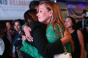 Patricia Villaraigosa (R), wife of former Los Angeles Mayor Antonio Villaraigosa, is embraced at an election night party concluding Villaraigosa's run for governor on June 5, 2018 in Los Angeles, California. California voters cast ballots in important primaries across the state.