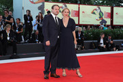 Brady Corbet (L) and Mona Fastvold walk the red carpet ahead of the 'Vox Lux' screening during the 75th Venice Film Festival at Sala Grande on September 4, 2018 in Venice, Italy.