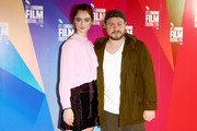 """Raffey Cassidy and director Brady Corbet attend the UK Premiere of """"Vox Lux"""" at the 62nd BFI London Film Festival on October 15, 2018 in London, England."""