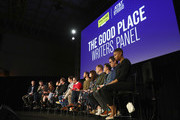 (L-R) Marc Evan Jackson, Michael Schur, Megan Amram, Jen Statsky, Josh Siegal, Dylan Morgan, Matt Murray, Cord Jefferson, Kassia Miller, Dan Schonfield, Andrew Law, Chris Encell, and Rae Sanni attend 'The Good Place Writers Panel' during Vulture Festival Presented By AT&T at Hollywood Roosevelt Hotel on November 18, 2018 in Hollywood, California.