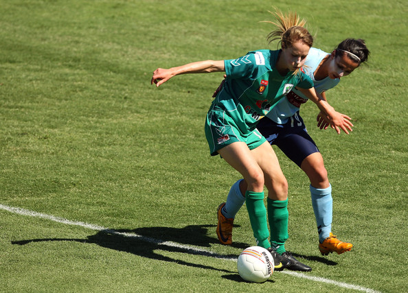 Ellyse Perry Ellyse Perry of Canberra United and Leena Khamis of Sydney FC