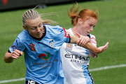 Teigen Allen of Sydney FC and Beattie Goad of Melbourne City compete fir the ball during the 2016 W-League Grand Final match between Melbourne Victory and Sydney FC at AAMI Park on January 31, 2016 in Melbourne, Australia.
