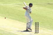 Cameron White of Victoria looks back at his stumps after being bowled by Marcus Stoinis of Western Australia during day two of the Sheffield Shield match between Western Australia and Victoria at the WACA on October 17, 2018 in Perth, Australia.
