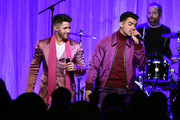 "(L-R) Nick Jonas and Joe Jonas of The Jonas Brothers perform onstage during WCRF's ""An Unforgettable Evening"" at Beverly Wilshire, A Four Seasons Hotel on February 27, 2020 in Beverly Hills, California."