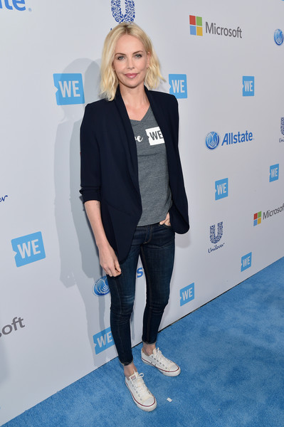 Charlize Theron spruced up a simple V-neck tee with a navy blazer for WE Day California.