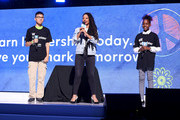 Edward Chok, Monique Coleman and Jada Warren-Fitts speak onstage during WE Day UN 2019 at Barclays Center on September 25, 2019 in New York City.