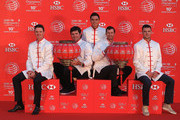 (L to R) Justin Rose of England, Bubba Watson and Rickie Fowler of the United States, Adam Scott of Australia and Martin Kaymer of Germany hold traditional Chinese lanterns atop the Peninsula Hotel prior to the start of the WGC - HSBC Champions on November 4, 2014 in Shanghai, China.