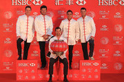 (L to R) Justin Rose of England, Bubba Watson of the United States, Adam Scott of Australia, Rickie Fowler of the United States and Martin Kaymer of Germany hang traditional Chinese lanterns atop the Peninsula Hotel prior to the start of the WGC - HSBC Champions on November 4, 2014 in Shanghai, China.