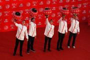 Justin Rose of England, Bubba Watson and Rickie Fowler of the United States, Adam Scott of Australia and Martin Kaymer of Germany hang traditional Chinese lanterns atop the Peninsula Hotel prior to the start of the WGC - HSBC Champions on November 4, 2014 in Shanghai, China.