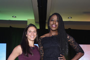Soccer champion Carli Lloyd and WNBA player Chiney Ogwumike pose for a photo onstage during the WICT Leadership Conference at Marriott Marquis Times Square on September 25, 2017 in New York City.