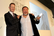 Sir Nicholas Serota (L) presents Ai Weiwei with an award at the WSJ Magazine 2016 Innovator Awards at Museum of Modern Art on November 2, 2016 in New York City.