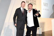Sir Nicholas Serota (L) presents Ai Wi Weiwei with an award at the WSJ Magazine 2016 Innovator Awards at Museum of Modern Art on November 2, 2016 in New York City.