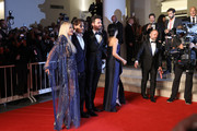 """(L-R) Monika Bacardi, Johnny Depp, Andrea Iervolino and Andrea Iervolino walk the red carpet ahead of the """"Waiting For The Barbarians"""" screening during the 76th Venice Film Festival at Sala Grande on September 06, 2019 in Venice, Italy."""