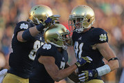 John Goodman #81 of the Notre Dame Fighting Irish (L), Troy Niklas #85 (L) and T.J. Jones #7 celebrate after Goodmans' touchdown catch against the Wake Forest Demon Deacons at Notre Dame Stadium on November 17, 2012 in South Bend, Indiana. Notre Dame defeated Wake Forest 38-0.