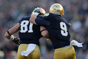 John Goodman #81 of the Notre Dame Fighting Irish and Robby Toma #9 celebrate as they run off of the field after Goodmans' touchdown catch against the Wake Forest Demon Deacons at Notre Dame Stadium on November 17, 2012 in South Bend, Indiana. Notre Dame defeated Wake Forest 38-0.