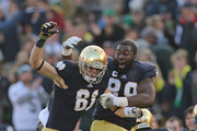 John Goodman #81 of the Notre Dame Fighting Irish (L) celebrates with Kapron Lewis-Moore #89 after catching a touchdown pass against the Wake Forest Demon Deacons at Notre Dame Stadium on November 17, 2012 in South Bend, Indiana.