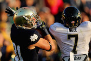 John Goodman #81 of the Notre Dame Fighting Irish catches a touchdown pass next to Merrill Noel #7 of the Wake Forest Demon Deacons at Notre Dame Stadium on November 17, 2012 in South Bend, Indiana. Notre Dame defeated Wake Forest 38-0.