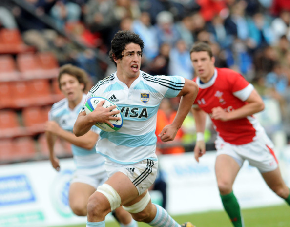 Tomas De La Vega Argentina's Tomas de La Vega makes a move towards the Welch defense during a 2010 IRB World Junior Championship 5th Place Semi Final rugby match between Wales and Argentina at the CA Colon stadium on June 17, 2010 in Santa Fe, Argentina.