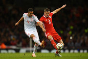 Andy King of Wales and Koke of Spain battle for the ball during the International Friendly match between Wales and Spain on October 11, 2018 in Cardiff, United Kingdom.