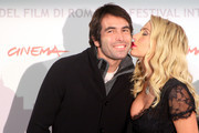 """Director Christian Molina (L) and actress Valeria Marini attend the """"I Want To Be  A Soldier"""" photocall during the 5th International Rome Film Festival at Auditorium Parco Della Musica on November 2, 2010 in Rome, Italy."""