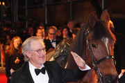 Director Steven Spielberg pats Joey, the War Horse during the UK premiere of War Horse at Odeon Leicester Square on January 8, 2012 in London, England.