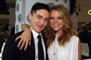 "In this handout photo provided by Warner Bros, Robin Lord Taylor and Erin Richards of ""Gotham"" attend Comic-Con International 2014  on July 26, 2014  in San Diego, California."
